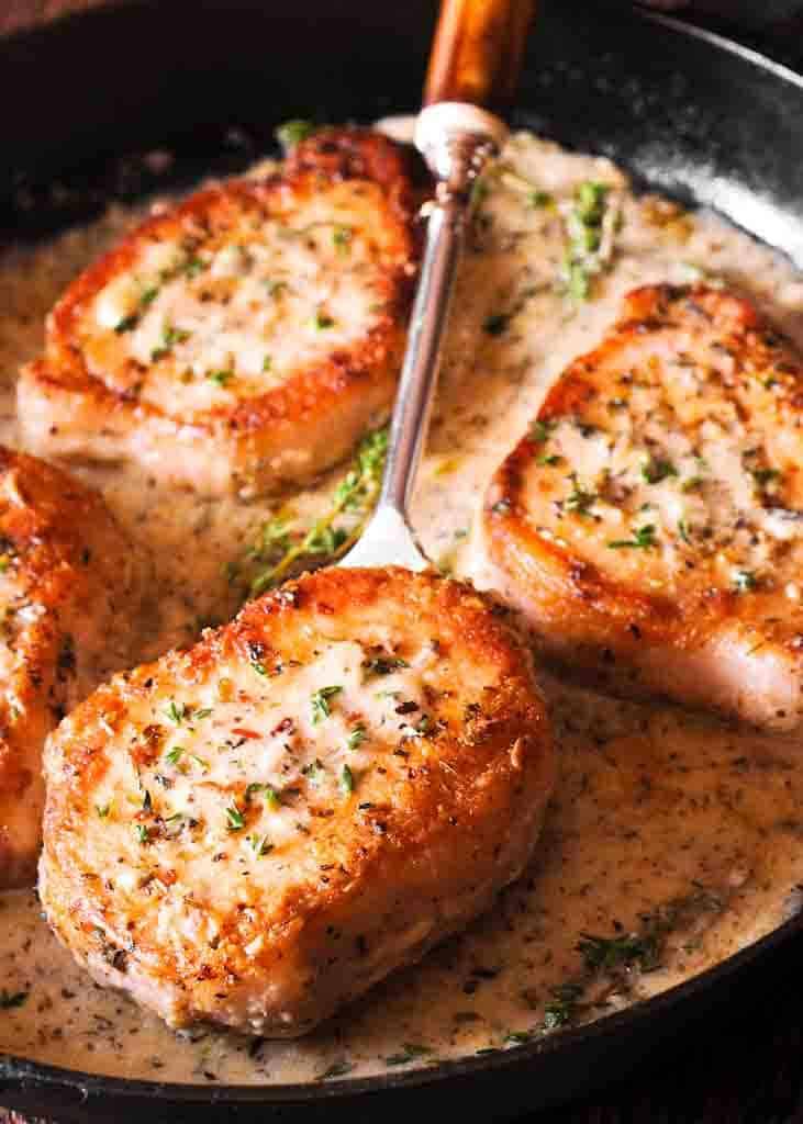 3. Skillet Pork Chops in Creamy Garlic & Herb Wine Sauce