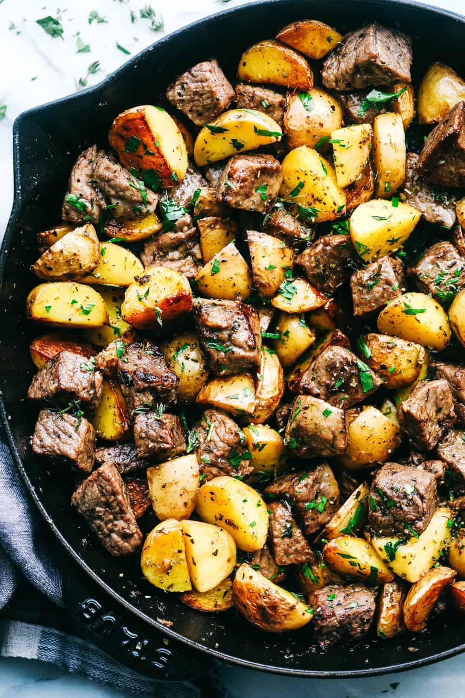 8.Garlic Butter Herb Steak Bites with Potatoes