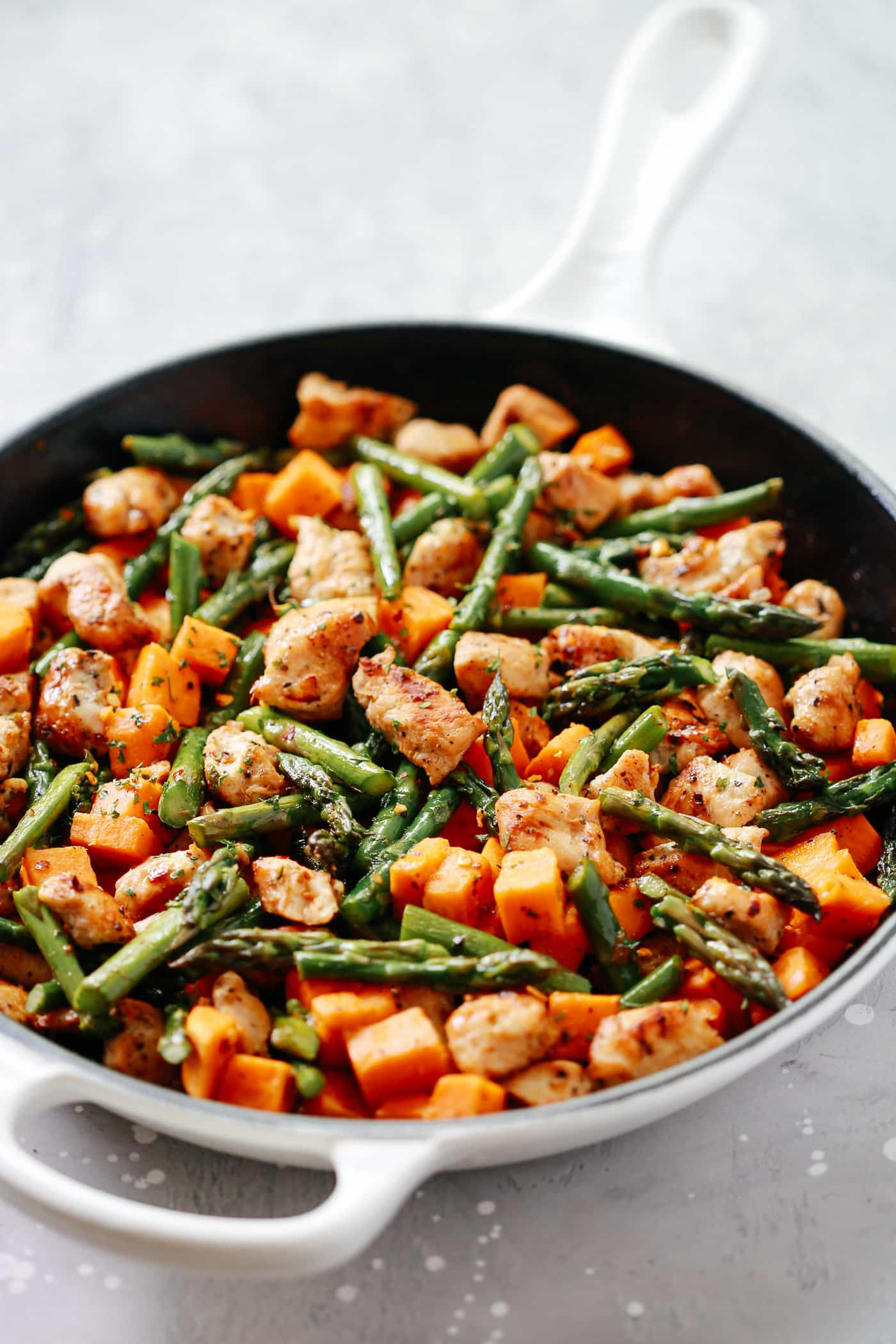 13. This Asparagus Sweet Potato Chicken Skillet