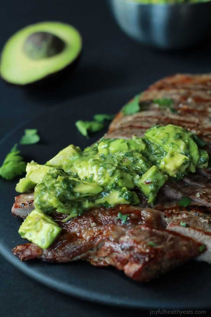 #23 Juicy Grilled Flank Steak topped with a fresh Avocado Chimichurri